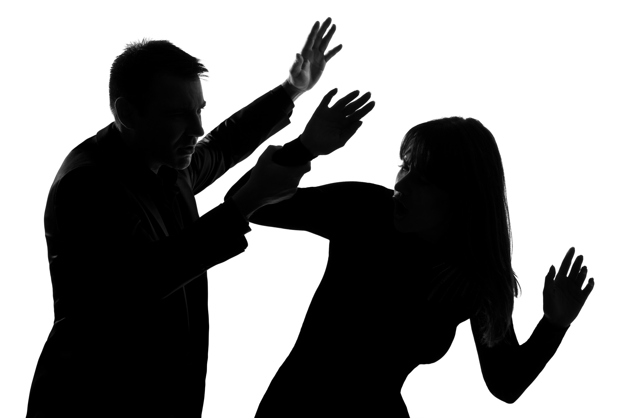 Silhouettes of a man and a woman during an altercation
